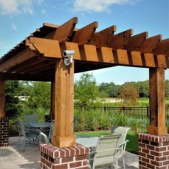 wood pergola made by Finyl Sales Inc on porch by river